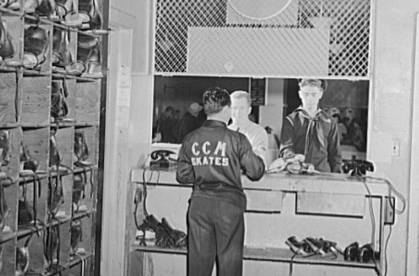 Servicemen returning skates which were rented to them for the evening by the Chevy Chase Ice Palace.