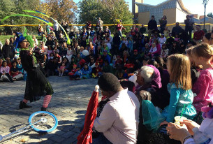Witchy Witch performed for a crowd at the amphitheater shortly after the renovated playground reopened last October.