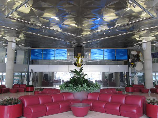 Lobby at Intelsat's main entrance at 3400 International Drive, with INTELSAT VII model on view