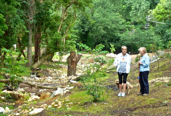 Ellen Malcolm and Marjorie Rachlin inspect the newly created stream bed.