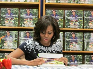"""The First Lady signing her book, """"American Grown,"""" at Politics and Prose on May 7th. (photo courtesy Politics and Prose)"""