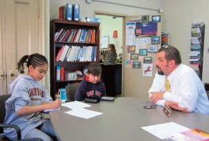 Murch principal Chris Cebrzynski meets the fifth grade press. (photo by Henry Daschle)