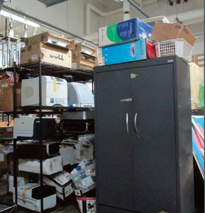 A peek into the basement storage room, as it looked in March. Note the old Murch student trophies high on a shelf at the upper left. (photo by Simon Holland)