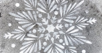 Why are giant snowflakes on the sidewalk at Van Ness? They're there to guide us