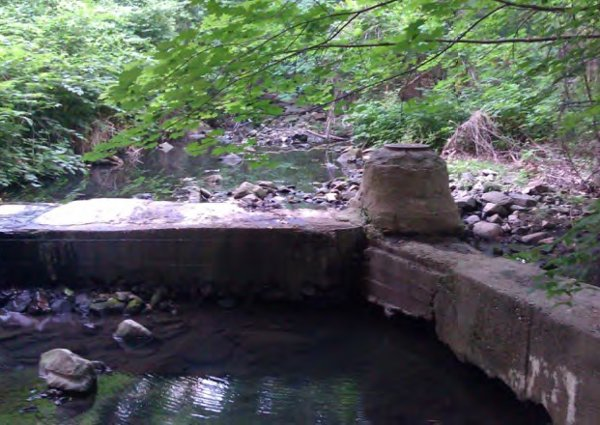 Exposed manhole and sewer crossing in the Soapstone Valley.
