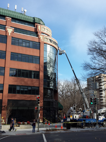 Workers installed the WAMU 88.5 sign on December 21st, 2014.