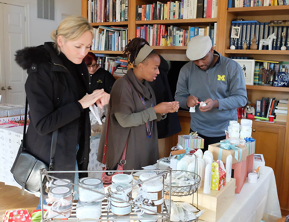 Sampling the potions and lotions made by AromabyAnette (photo courtesy of Phil Taplin)