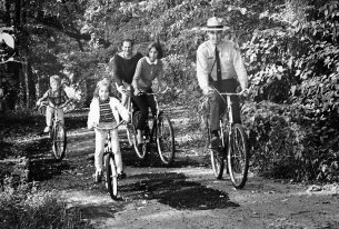 A ranger leads a family on a Rock Creek bike ride, September 1967. (photo provided by NPS)