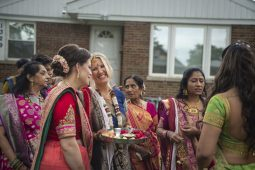 Guests mingle after a traditional Indian ceremony in the front yard on Friday, Aug. 16, during a pre-wedding celebration in Forest Park. | ALEXA ROGALS/Staff Photographer