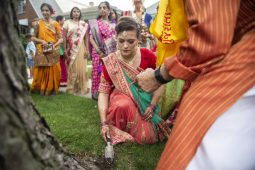 Guests participate in a traditional Indian ceremony on Friday, Aug. 16, during a pre-wedding celebration in Forest Park. | ALEXA ROGALS/Staff Photographer