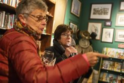 Maureen Pond, left, of Oak Park, and Kim Lavin, of Berwyn, try out different samples of wine on Nov. 2, during the annual Fall Wine Walk and Shop event at Centuries and Sleuth's bookstore on Madison Street in downtown Forest Park. | ALEX ROGALS/Staff Photographer