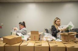 Volunteers pack up the Thanksgiving meal deliveries on Wednesday, Nov. 27, 2019, at the Howard Mohr Community Center on Des Plaines Avenue in Forest Park, Ill. | ALEX ROGALS/Staff Photographer