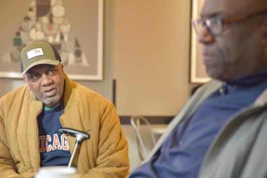 Ira Carswell, top left, and Walt Williams, below, reminisce on their 1969 state title at a local Starbucks. The win helped heal the racial divide at Proviso East High School. | Photo by Shanel Romain