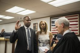 Rory Hoskins, with wife Monique Hoskins, is sworn in as the first black mayor of Forest Park on May 13. | Alex Rogals/Staff Photographer