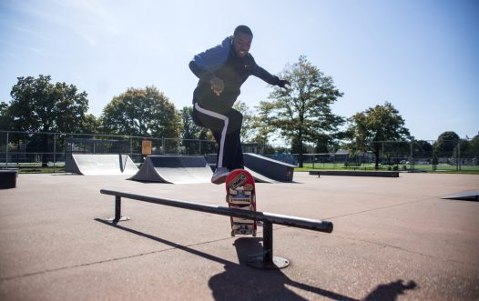 Cory Poe, Oak Park, lands a trick on Oct. 14 at the skate park on Harrison Street. | Alex Rogals/Staff Photographer