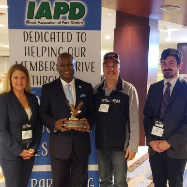 "Emanuel ""Chris"" Welch received the Legislator of the Year award. From left: Jackie Iovinelli (park district executive director), Chris Welch, Roy Sansone (park board president), Matt Walsh (park board commissioner)."