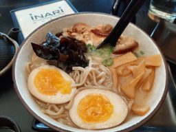 Ramen: Tonkatsu ramen at Inari features hand made noodles, pork broth, pork belly and soft-boiled egg with bamboo shoots, mushrooms and garlic oil. (Photo credit Melissa Elsmo)