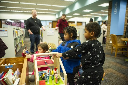 Kids play with toys on Saturday, Feb. 8, 2020, during the re-opening party at the Forest Park Public Library on Des Plaines Avenue in Forest Park, Ill. | ALEX ROGALS/Staff Photographer
