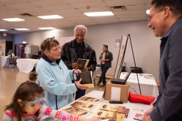 """Pam Woods and Ernie Hines (left to right) both of Forest Park talking with the author of """"Images of America-Forest Park,"""" Kenneth J Knack who was on hand to sign copies of his book at the Leap Day History & Community Festival. 