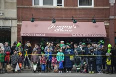Parade goers watch the 2019 parade in front of Jimmy's Place on Madison Street. The 2020 St. Patrick's Day parade will be held on March 7, kicking off at 1 p.m. on Madison Street. | File photo