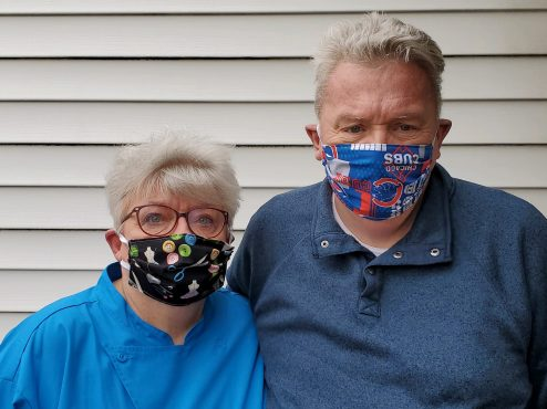 Sandy Byrnes, pictured with husband Joe Byrnes, has been sewing masks at home to donate to people who need them. | Photo provided