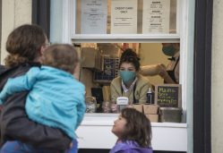 Rebekah Gaskill wears a mask while taking orders at Brown Cow's new walk-up window. | Alex Rogals, Staff Photographer