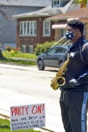 Members of the Proviso East Marching Band played outside the home of Evangeline Bonwit to help celebrate her 6th birthday on May 6. | Photo by Betty Alzamora