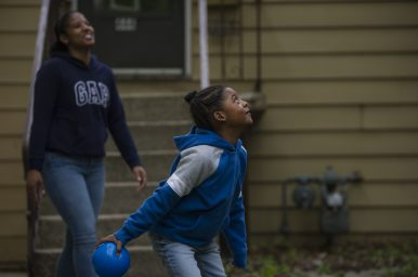 Denita Johnson (left) plays with her son Christian outside their house in Forest Park. Since the schools have closed, Johnson, like many other parents of children with special needs, has learned to fill the role of teachers and support staff he no longer sees in person. | Alex Rogals, Staff Photographer