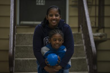 Denita Johnson with her son Christian outside their house in Forest Park. Since the schools have closed, Johnson, like many other parents of children with special needs, has learned to fill the role of teachers and support staff he no longer sees in person. | Alex Rogals, Staff Photographer