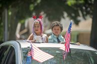 Rosabella and Jeremiah Manzaneres participate in the goodbye parade for Leslie Compere and Bill Milnamow on June 8. | Alex Rogals, Staff photographer
