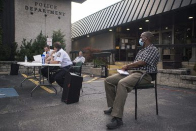 Mayor Rory Hoskins (right) at the Forest Park police department forum on July 9. | Alex Rogals, Staff Photographer