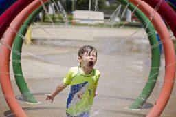 Max Bozman of Forest Park enjoys the park district's spray ground, which recently reopened to residents.| Alex Rogals, Staff Photographer
