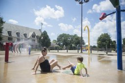 Rose (left) and Max Bozman of Forest Park enjoy the park district's spray ground, which recently reopened to residents. | Alex Rogals, Staff Photographer