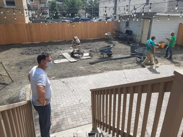 Owner Patrick O'Brien shows off the back yard at Lathrop House Caf?, which will have plenty of seating, bocce ball, a BBQ pit and a bar suitable for a variety of private events. | Melissa Elsmo