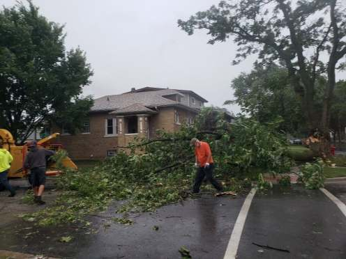 Public Works cleans up trees after storm on Aug. 10 caused damage throughout town. | Photo by Jill Wagner