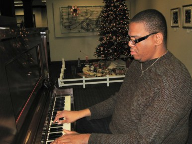Holiday Tunes: James Robinson-Parran performed in the lobby of the Forest Park National Bank.
