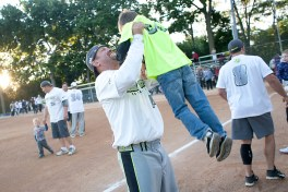 Rich Kaczmanski greets his son, Casey, 5, after his team, Windy City, defeated OBI 8-6 in the 2013 No Gloves Nationals title game. (David Pierini/staff photographer)