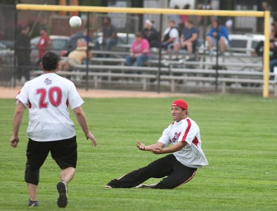 Monkey Softball right fielder George Beres slides in to make a catch against the Nature Boys. (David Pierini/staff photographer)