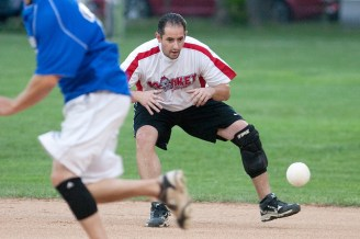 Monkey Softball second baseman Mike Lock keeps his eye on a grounder in a game against the Nature Boys. (David Pierini/staff photographer)