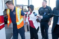 An injured woman is helped into an ambulance. (David Pierini/staff photographer)