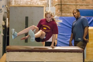 Annaliese Miller, of Oak Park, leaps over an obstacle at LivFit Gym in Forest Park during a Parkour class taught by Paul Canada, a former Ringling Brothers circus acrobat trainer. Parkour is a form of street acrobatics inspired by military obstacle course training.
