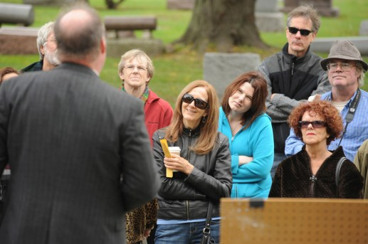 electrifying: Nancy Stapp (center) and Heather Anderson (right) both of Oak Park, enjoy the portrayal of radio millionaire William Grunow by Kevin Bry of Oak Park at Forest Home Cemetery. (JENNIFER WOLFE/Contributor)