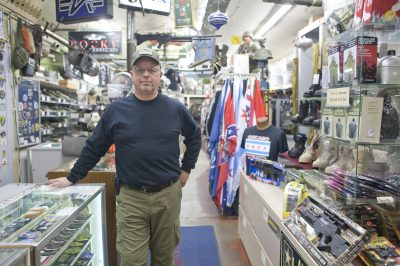 Retired to Retail: Former Forest Park police officer Mike Cody has owned Military and Police Supply on Madison in Forest Park for the last seven years. The store first opened in 1977. (David Pierini/Staff Photographer)