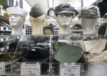Hats Off: Gear of all kinds can be found at Miltary and Police Supply in Forest Park. (David Pierini/Staff Photographer)