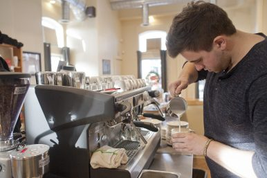 Coffee bar: Waylen Smith makes a latte at Counter Coffee in Forest Park. (David Pierini/staff photographer)
