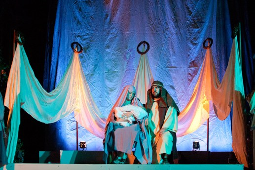 The festival concludes with the birth of Jesus. Courtney and Daniel Regan are Mary and Joseph and they are holding Emmett Regan. (David Pierini/staff photographer)