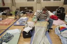 Tony Yusken 49, prepares his bed for the night at a PADS shelter at St. John Lutheran Church in Forest Park Friday night. Yusken, one of 48 at the shelter that night, said he has been homeless since October 2011. (David Pierini/staff photographer)