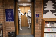 A pair of storm troupers make a friendly exit from the main floor of the Forest Park Public Library Saturday during Mini Comicon. Though the event was held in the basement, the Star Wars characters could not resist interacting with library patrons. (David Pierini/staff photographer)