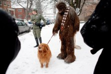 A passerby asked Chewbacca, played by Patrick Klehr, to hold his dog for a picture as he and other Star Wars characters cooled off in the winter air outside the Forest Park Public Library Saturday. The devoted movie buffs were their for the library's first Mini Comicon. (David Pierini/staff photographer)