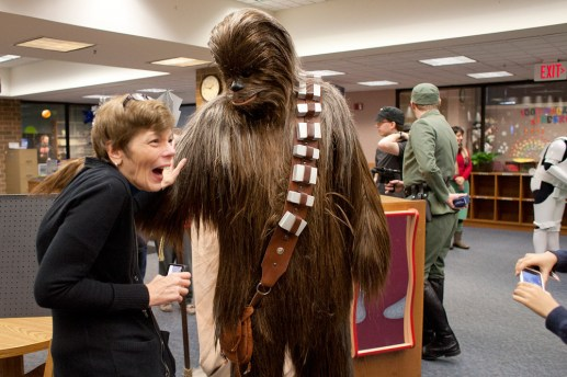 Deb Harris was completely smitten with Chewbacca because of his soft fur. As people took the opportunity to pet him, Chewiee, played by Patrick Klehr, would pet them back. (David Pierini/staff photographer)